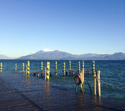 Garda lake and snowy mountains Stock Image