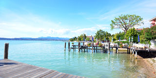 Garda Sirmione pontoon. Garda Sirmione city italy lake shore landscape Royalty Free Stock Image