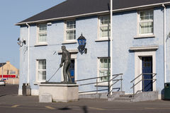 Garda station in Ballybunion county Kerry, Ireland. With Bill Clinton statue Stock Photos