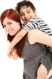 Garde d'enfants donnant sur le dos la conduite image libre de droits