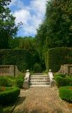 Garden. Lush garden with brick walkway and wonderful sky Stock Image