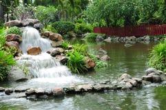-garden. Waterfall in the big garden Stock Photos