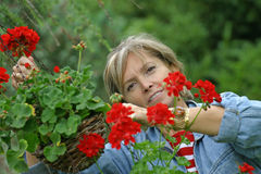 In the garden [3]. A middle aged woman smiling in the garden Stock Image