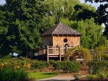 Garden. Wooden gazebo in the spring garden royalty free stock photo