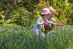 Garden. Little girl and mother picking flowers Royalty Free Stock Photos