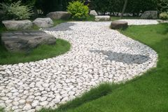 Garden. A stone walkway through an Asian garden