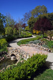 Garden. A stone path in a garden stock photo