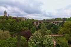 Garden and Adolphe bridge over Petrusse valley in Luxembourg city. Spring urban landscape photo. Luxembourg royalty free stock photo