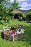 Garden with alpine slide Stock Photos