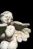 Garden angel statue. On the black background Royalty Free Stock Photography