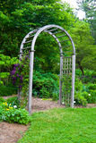 Garden Arbor. Wooden garden arbor with plants beginning to grow up and around it Royalty Free Stock Image
