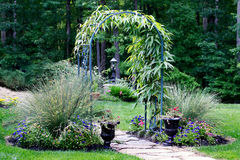 Garden arbor leading to forest path Royalty Free Stock Images