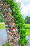 Garden arch in stone the conifers. The territory of the Central Siberian Botanical garden, Novosibirsk, Siberia, Russia - June 25, 2017: garden arch with Stock Photos