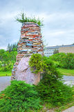 Garden arch in stone the conifers. The territory of the Central Siberian Botanical garden, Novosibirsk, Siberia, Russia - June 25, 2017: garden arch with Stock Image