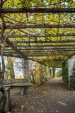 Garden archway passage in Autumn Royalty Free Stock Image