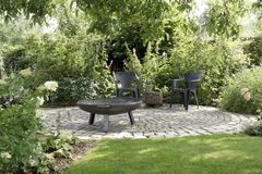 Garden area with chairs Royalty Free Stock Photo