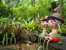 Garden art. Female and Male toys in garden art Royalty Free Stock Photos