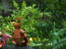 Garden art. Jardiniere doll in garden art Stock Photography