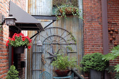 Garden Art and Plants Decorate a Red Brick Alley Royalty Free Stock Images