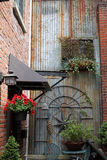 Garden Art and Plants Decorate a Red Brick Alley Royalty Free Stock Photos