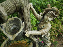 Garden art. Statue of boy in garden art Royalty Free Stock Image