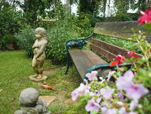Garden art. Statue of girl in garden art Royalty Free Stock Photo