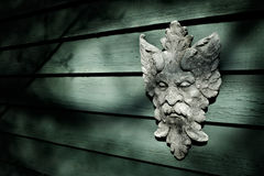 Garden Bacchus. Stone Bacchus on green wall Royalty Free Stock Photography