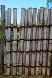 Garden bamboo fence. Bamboo fence in the garden in summer time Royalty Free Stock Images