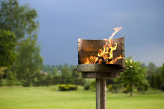 Garden Barbecue. A shiny metal barbecue with burning charcoal Royalty Free Stock Image
