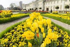 Garden of a baroque castle. Garden full of flowers close to a historic baroque castle Royalty Free Stock Photo