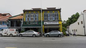 Cars park in front of Islamic Restaurant stock photography