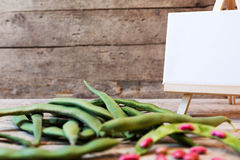 Garden beans on wooden table Stock Images