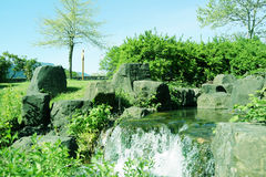 Garden. Beautiful garden with rocks and water stream Stock Images