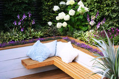 Garden bench. With fresh plants stock photography