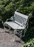 Garden bench. A bench in a garden Stock Images