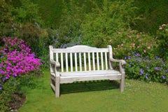 Garden bench. Wooden bench in summer garden Royalty Free Stock Photography