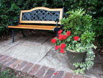 Garden Bench. With Planter in Summer stock images