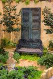 Garden Bench. With statues and plants royalty free stock photography