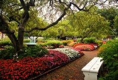 Garden Bench. A white bench in the garden Royalty Free Stock Photography