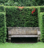 Garden Bench. In an english country garden Stock Photos