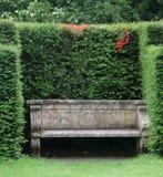Garden Bench. In an english country garden stock photos