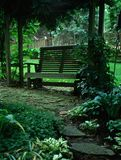 Garden Bench. Bench under foliage Royalty Free Stock Photos