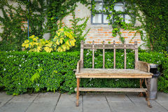 Garden Bench At Blick Wall And Green Leaf Royalty Free Stock Images