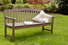 Garden bench book cushion Stock Photos