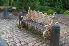 Garden bench. On a cobblestone pavement in the courtyard stock photo