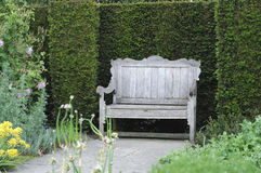 Garden bench in English garden Stock Photo