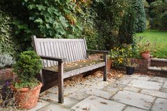 Garden bench in fall royalty free stock images