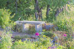 Garden bench made of stone Royalty Free Stock Photo