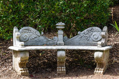 Garden bench. Old fashioned marble garden bench royalty free stock image