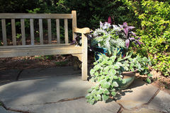 Garden bench and planters horizontal Royalty Free Stock Image